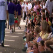 Stock Video: Spectators watch parade