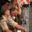 Stock Video: Boy Scouts watch parade