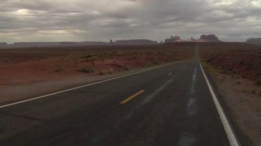 Jib shot up Monument Valley Highway — Stock Video