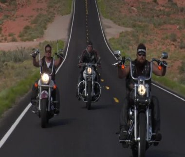 Three bikers on a desert straight highway — Stock Video