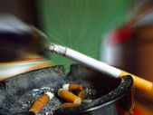 Cigarette and ashtray — Stock Photo