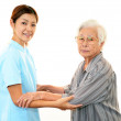 Friendly nurse cares for an elderly woman — Stock Photo #18870709