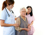Medical staff with senior woman — Stock Photo