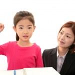 Smiling girl with teacher — Stock Photo