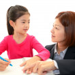 Teacher with girl studying. — Stock Photo