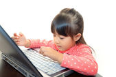 Cute little girl using a laptop — Stock Photo