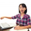 Smiling girl using a laptop — Stock Photo #19154577