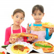 Smiling girls carrying meals — Stock Photo #19154623