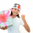 Joyful girl holding present in hands — Stock Photo #19154687