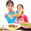 Happy girls eating meals — Foto Stock