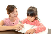 Child with mother studying — Stock Photo