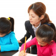 Teacher with girls studying. — Stock Photo
