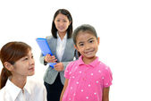 Smiling teacher with girl — Stok fotoğraf