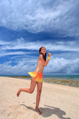 Woman running at the beach — Stock Photo