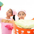 Child carrying laundry basket — Stock Photo #19505221