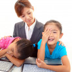 Girls using laptop — Stock Photo