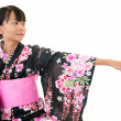 Smiling girl wearing a kimono — Stock Photo