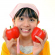 Smiling girl holding vegetables — Stock Photo