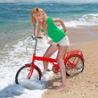 Royalty-Free Stock Photo: Girl Riding a Bike on the Beach