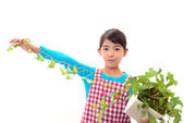 Girl holding a plant in her hand — Stock Photo