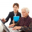Senior lady enjoys computer — Stockfoto