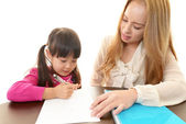 English teacher with girl studying. — Stock Photo