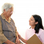Friendly nurse cares for an elderly woman — Stock Photo #20348295