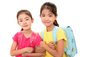 Smiling Asian girls with backpack — Stock Photo