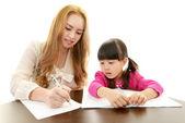 English teacher with girl studying. — Stock Photo