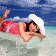 The woman who relaxes on the beach. — Stock Photo #20564695