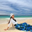 The woman who relaxes on the beach. — Stock Photo