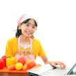 Smiling girl using a laptop — Stock Photo #21162285