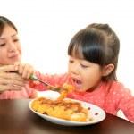 Child eating spaghetti — Stock Photo #21270193