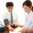 Doctor examining a patient — Stock Photo #21669323