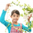 Smiling girl with plant — Stock Photo
