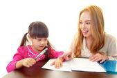 Dziewczynka studia w języku angielskim z nauczycielem — Zdjęcie stockowe