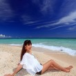 The woman who relaxes on the beach. — Stock Photo #21879017