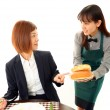 Waitress delivering meal to table — Stock Photo