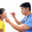 Doctor examining a patient — Stock Photo