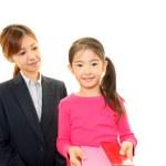 Smiling teacher with girl — Stock Photo