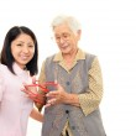 Friendly nurse cares for an elderly woman — Stock Photo #22004573