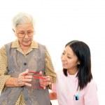 Friendly nurse cares for an elderly woman — Stock Photo #22347231