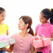 Smiling girls with mother — Stock Photo