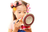 Little girl with makeup — Stock Photo