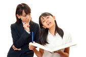 Professor com menina estudando. — Fotografia Stock