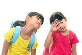 Müde asiatische schulmädchen — Stockfoto