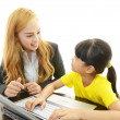 Stock Photo: Teacher with girl studying.