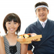 Sushi chef and customer — Stock Photo #28881167