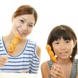 Child with mother eating meals — Stock Photo