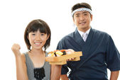 Sushi chef and customer — Stock Photo